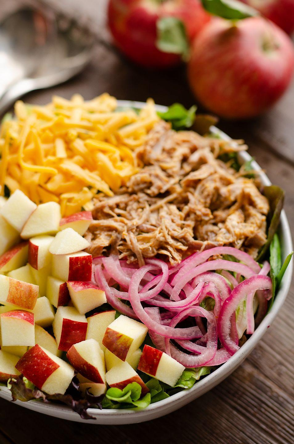 """<p>You can use leftover pulled pork to make a ton of great meals—including this light and flavorful fall salad. Pair it with leafy greens, crisp apples, and shredded cheese for an easy weeknight dinner. </p><p><strong>Get the recipe at <a href=""""https://www.thecreativebite.com/pulled-pork-apple-salad/"""" rel=""""nofollow noopener"""" target=""""_blank"""" data-ylk=""""slk:The Creative Bite"""" class=""""link rapid-noclick-resp"""">The Creative Bite</a>. </strong></p><p><a class=""""link rapid-noclick-resp"""" href=""""https://go.redirectingat.com?id=74968X1596630&url=https%3A%2F%2Fwww.walmart.com%2Fsearch%2F%3Fquery%3Dpressure%2Bcooker&sref=https%3A%2F%2Fwww.thepioneerwoman.com%2Ffood-cooking%2Fmeals-menus%2Fg36806222%2Ffall-salad-recipes%2F"""" rel=""""nofollow noopener"""" target=""""_blank"""" data-ylk=""""slk:SHOP PRESSURE COOKERS"""">SHOP PRESSURE COOKERS</a></p>"""