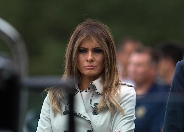 Alas, the first lady is seen without her sunglasses, proving that it's her. (Photo: AP Images)