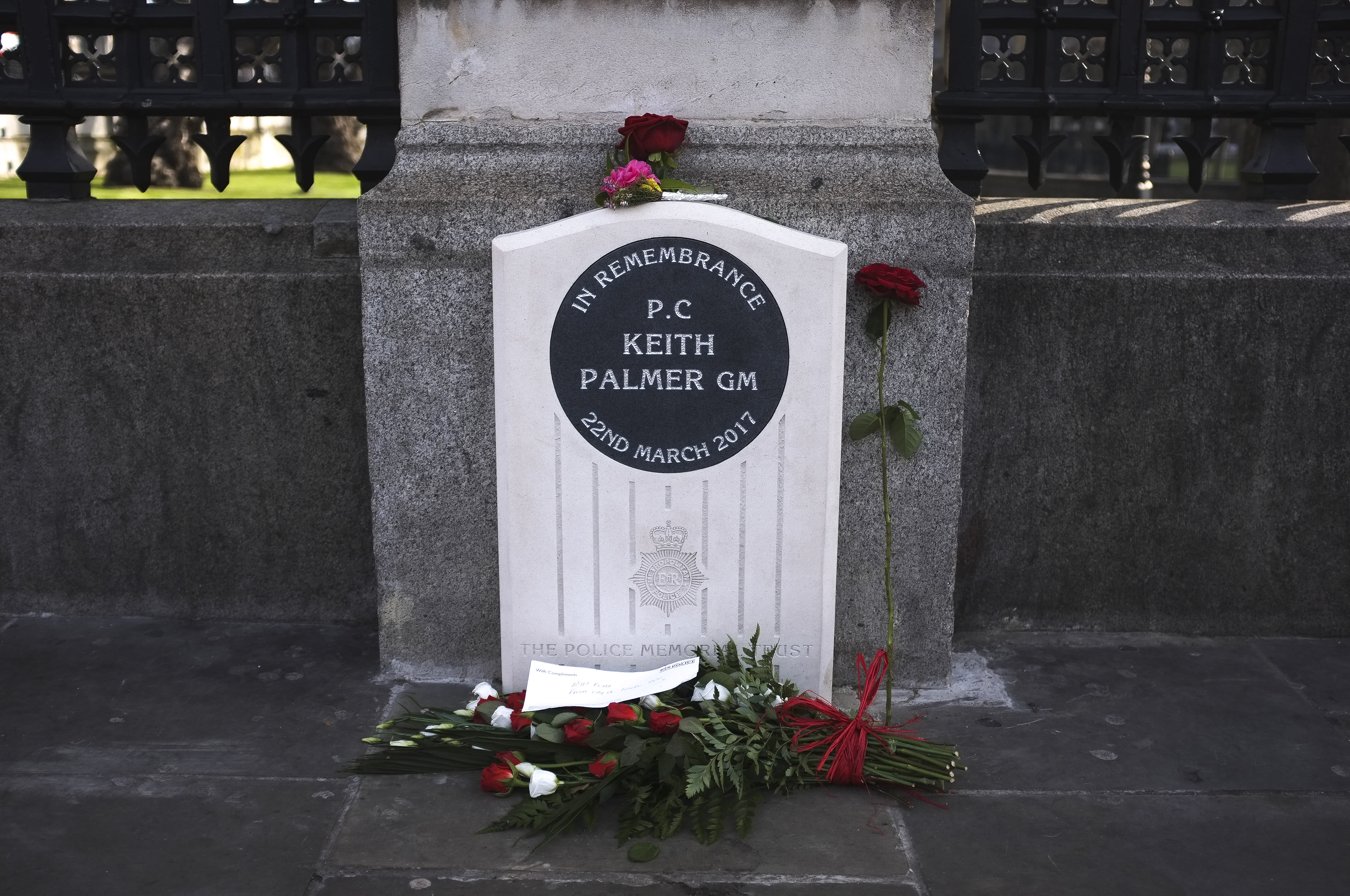 Pedestrians walk past the unveiled permanent memorial to PC Keith Palmer, the police officer killed in the March 22, 2017 Westminster terror attack, outside the Houses of Parliament in London on February 22, 2019. PC Keith Palmer was fatally stabbed as he stood guard in front of Britain's Houes of Parliament in Westminster on March 22, 2017 by Khalid Masood after the 52 year-old convert to Islam drove into pedestrians at high speed near parliament, killing four other people. (Photo by Alberto Pezzali/NurPhoto via Getty Images)