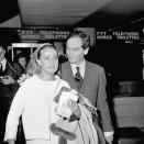 FILE - In this May 26, 1965 file photo, French actress Jeanne Moreau was welcomed by friend Pierre Cardin on her arrival at Orly airport in Paris. France's Academy of Fine Arts says famed fashion designer Pierre Cardin has died at 98. (AP Photo/Pierre Godot, File)