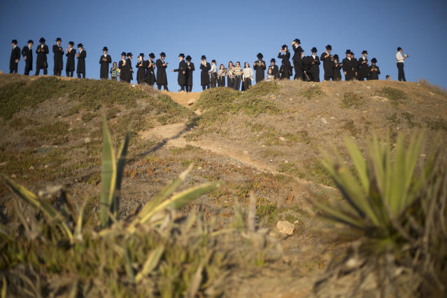"<p>Ultra-Orthodox Jewish men of the Vizhnitz Hassidic sect pray on a hill overlooking the Mediterranean Sea as they participate in a Tashlich ceremony in Herzeliya, Israel, Thursday, Sept. 28, 2017. Tashlich, which means ""to cast away"" in Hebrew, is the practice in which Jews go to a large flowing body of water and symbolically ""throw away"" their sins by throwing a piece of bread, or similar food, into the water before the Jewish holiday of Yom Kippur, which starts at sundown Friday. (Photo: Ariel Schalit/AP) </p>"