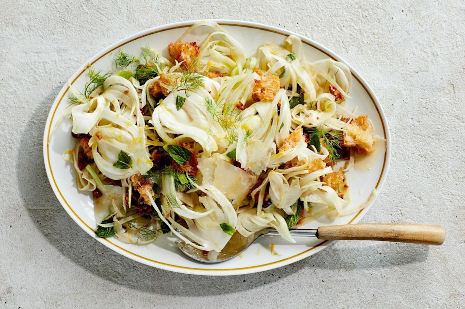 "If the rest of the meal is rich and comforting, you need a Rosh Hashanah salad like this one: crunchy fennel, toasty croutons, and all the acidity and zing you need, thanks to lemon juice, the zest, vinegar, mint, and red pepper flakes. <a href=""https://www.epicurious.com/recipes/food/views/shaved-fennel-salad?mbid=synd_yahoo_rss"" rel=""nofollow noopener"" target=""_blank"" data-ylk=""slk:See recipe."" class=""link rapid-noclick-resp"">See recipe.</a>"