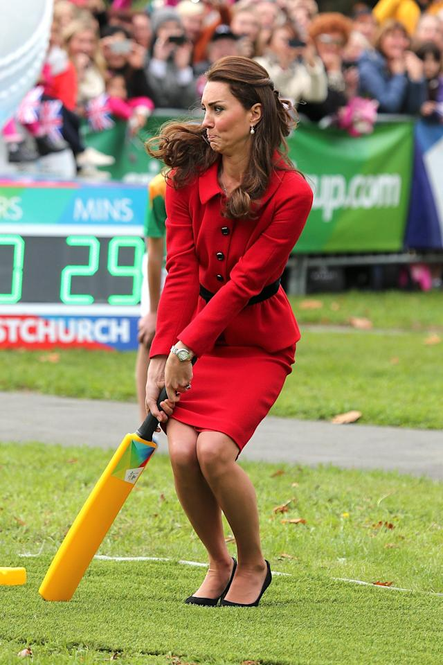CHRISTCHURCH, NEW ZEALAND - APRIL 14: Catherine, Duchess of Cambridge plays a game of cricket during a visit to Latimer Square on April 14, 2014 in Christchurch, New Zealand. The Duke and Duchess of Cambridge are on a three-week tour of Australia and New Zealand, the first official trip overseas with their son, Prince George of Cambridge. (Photo by Martin Hunter/Getty Images)