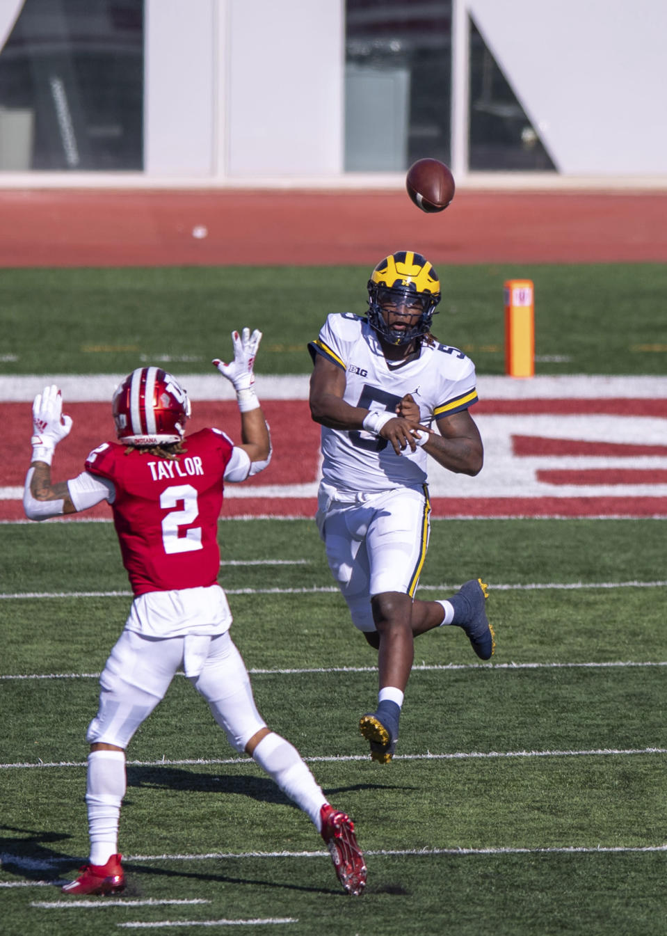Michigan quarterback Joe Milton (5) throws a pass during the first half of an NCAA college football game against Indiana, Saturday, Nov. 7, 2020, in Bloomington, Ind. (AP Photo/Doug McSchooler)
