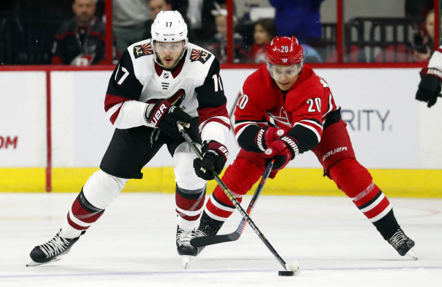 Arizona Coyotes' Alex Galchenyuk (17) keeps the puck away from Carolina Hurricanes' Sebastian Aho (20) during the first period of an NHL hockey game, Sunday, Dec. 16, 2018, in Raleigh, N.C. (AP Photo/Karl B DeBlaker)