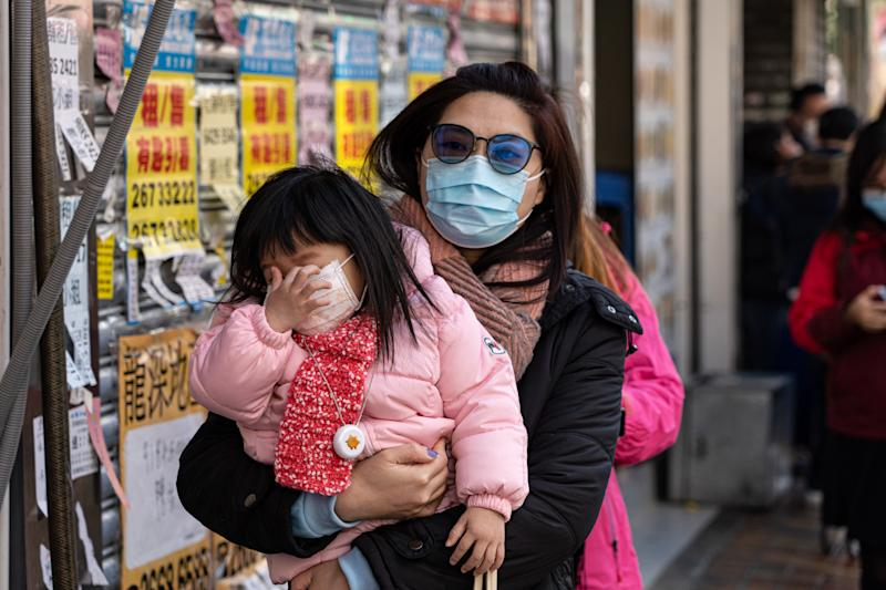 People wearing masks on the street in Hong Kong