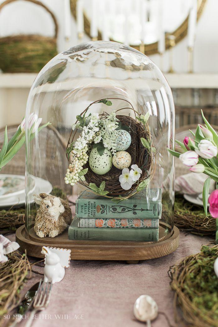 """<p>Looking to take your bunny decorations and rustic egg nests to the next level? Throw a cloche and a stack of pretty reading material into the mix. </p><p><strong>Get the tutorial at <a rel=""""nofollow noopener"""" href=""""https://somuchbetterwithage.com/bunnies-books-tulips-easter-table/"""" target=""""_blank"""" data-ylk=""""slk:So Much Better With Age"""" class=""""link rapid-noclick-resp"""">So Much Better With Age</a>.</strong></p><p><strong><a rel=""""nofollow noopener"""" href=""""https://www.amazon.com/Glass-Cloche-Bell-Display-Bamboo/dp/B012SXDACG/"""" target=""""_blank"""" data-ylk=""""slk:SHOP CLOCHES"""" class=""""link rapid-noclick-resp"""">SHOP CLOCHES</a><br></strong></p>"""