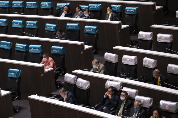 Members of the House, left and Senate, right attend a joint-session at the Parliament in Bangkok, Thailand, Wednesday, Nov. 18, 2020. Violent confrontations took place Tuesday outside Parliament between police and pro-democracy protesters who backed a motion to make substantive changes to the constitution. (AP Photo/Sakchai Lalit)
