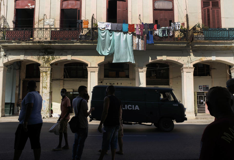 A police vehicle patrols through Old Havana, Cuba, Monday, July 12, 2021, the day after protests against food shortages and high prices amid the coronavirus crisis. (AP Photo/Eliana Aponte)