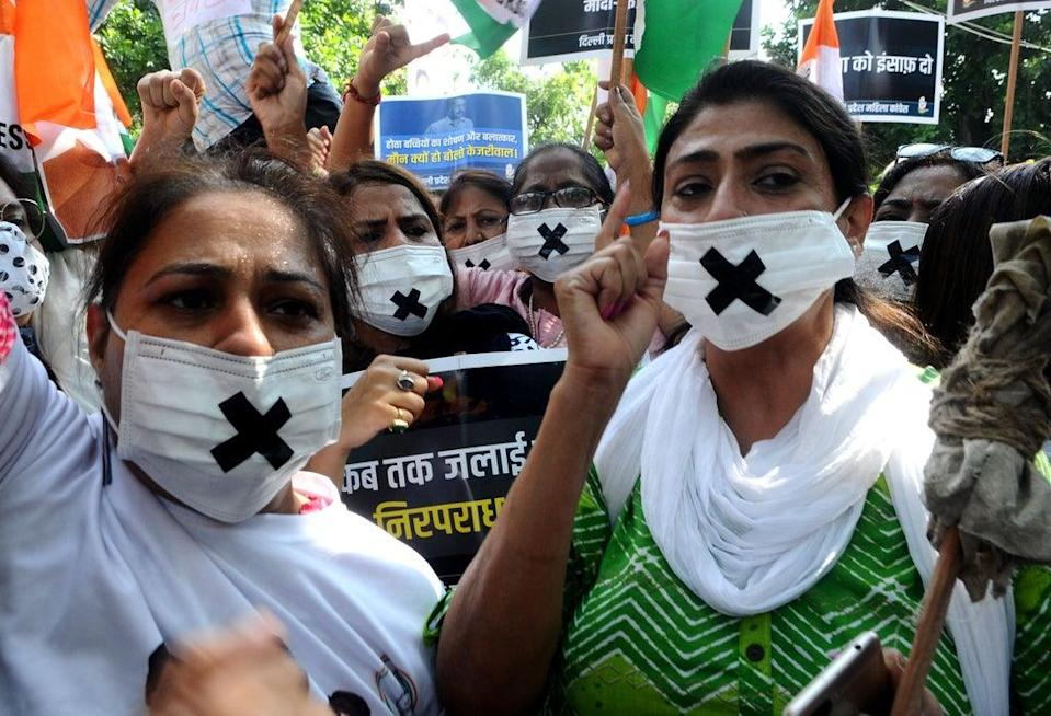 Members of the Congress women's wing protest against the alleged rape, murder and forceful cremation of a nine-year-old girl in Delhi (Anadolu Agency via Getty Images)