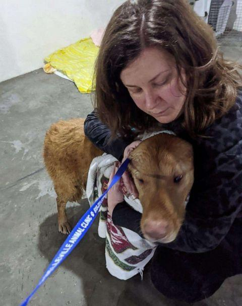 PHOTO: Kate Olson holding Walter after he was rescued.  (Kate Olson)