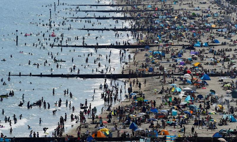 People are flocking to beaches such as Bournemouth during the heatwave.