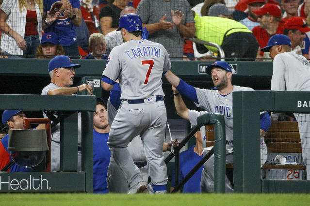 Chicago Cubs' Victor Caratini is congratulated by teammates as he enters the dugout after hitting a solo home run during the fifth inning of a baseball game against the St. Louis Cardinals, Saturday, Sept. 28, 2019, in St. Louis. (AP Photo/Scott Kane)