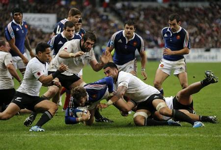 France's Maxime Medard is tackled during the rugby test match against New Zealand at the Stade de France in Saint-Denis