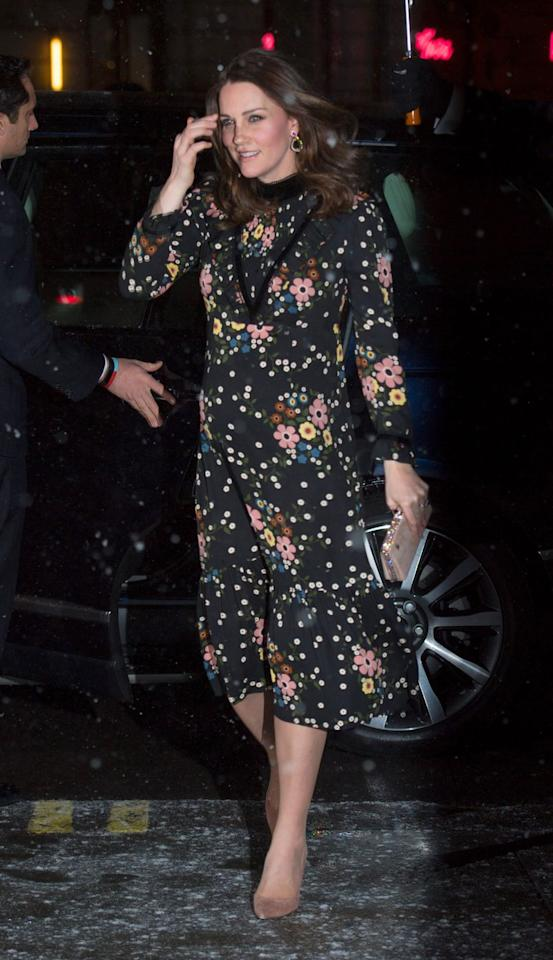 <p>In a Orla Kiely-designed black long-sleeved floral print dress with velvet detailing, paired with nude suede pumps, a small clutch, and gold teardrop earrings at the National Portrait Gallery in London.</p>