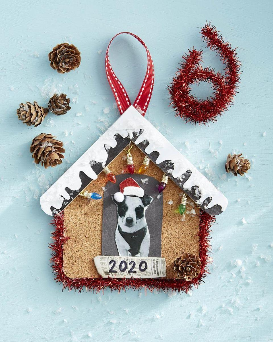 """<p>There isn't much that kids love more than their pooch, so why not make them a special ornament this year that celebrates the object of their affection?</p><p><strong>To make</strong><strong>:</strong> Cut a piece of cork to the shape of a small doghouse. Cut out a black piece of craft paper to resemble the doghouse door; glue a picture of the dog to the door. Glue to the cork. Trim two tongue depressors to the size needed to create a roof, overlapping trimmed ends at the point. Paint tongue depressor black. Cut snow from white craft paper and glue to roof. Glue mini craft lights to the back of the roof. Glue roof to the top of the cork house.</p><p><a class=""""link rapid-noclick-resp"""" href=""""https://www.amazon.com/Hygloss-Products-Rolled-Cork-Sheet/dp/B003JO5BOO/ref=sr_1_5?tag=syn-yahoo-20&ascsubtag=%5Bartid%7C10050.g.645%5Bsrc%7Cyahoo-us"""" rel=""""nofollow noopener"""" target=""""_blank"""" data-ylk=""""slk:SHOP CORK SHEETS"""">SHOP CORK SHEETS</a></p>"""