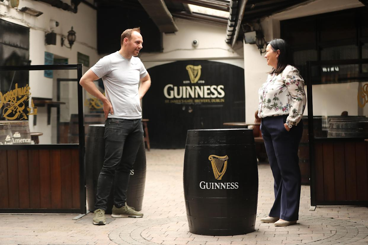 Kevin Barden and Grannie Wafer in the outdoor courtyard at O'Donoghue's (Niall Carson/PA)