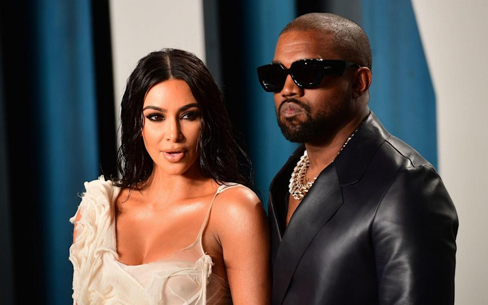 Kim Kardashian and Kanye west at the Vanity Fair Oscar Party in 2020 - PA