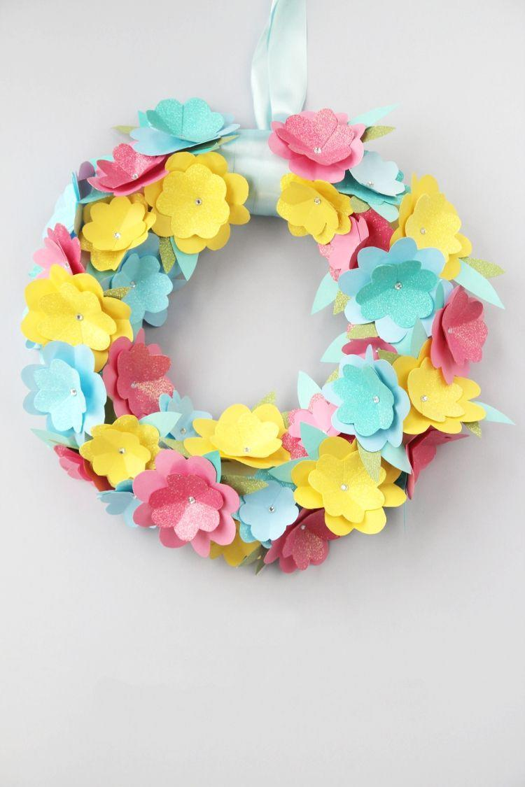 """<p>Using varying hues of card stock, you'll make your very own paper flowers to create this wreath. Don't forget the stick-on gemstones too.</p><p><strong>Get the tutorial at <a href=""""https://www.gatheringbeauty.com/blog/2016/02/diy-spring-paper-flower-wreath.html"""" rel=""""nofollow noopener"""" target=""""_blank"""" data-ylk=""""slk:Gathering Beauty"""" class=""""link rapid-noclick-resp"""">Gathering Beauty</a>.</strong></p><p><a class=""""link rapid-noclick-resp"""" href=""""https://go.redirectingat.com?id=74968X1596630&url=https%3A%2F%2Fwww.walmart.com%2Fip%2FGlue-Dots-125-Micro-Dot-Roll-325-Clear-Dots%2F42543794&sref=https%3A%2F%2Fwww.thepioneerwoman.com%2Fhome-lifestyle%2Fcrafts-diy%2Fg35698457%2Fdiy-easter-wreath-ideas%2F"""" rel=""""nofollow noopener"""" target=""""_blank"""" data-ylk=""""slk:SHOP GLUE DOTS"""">SHOP GLUE DOTS</a></p>"""