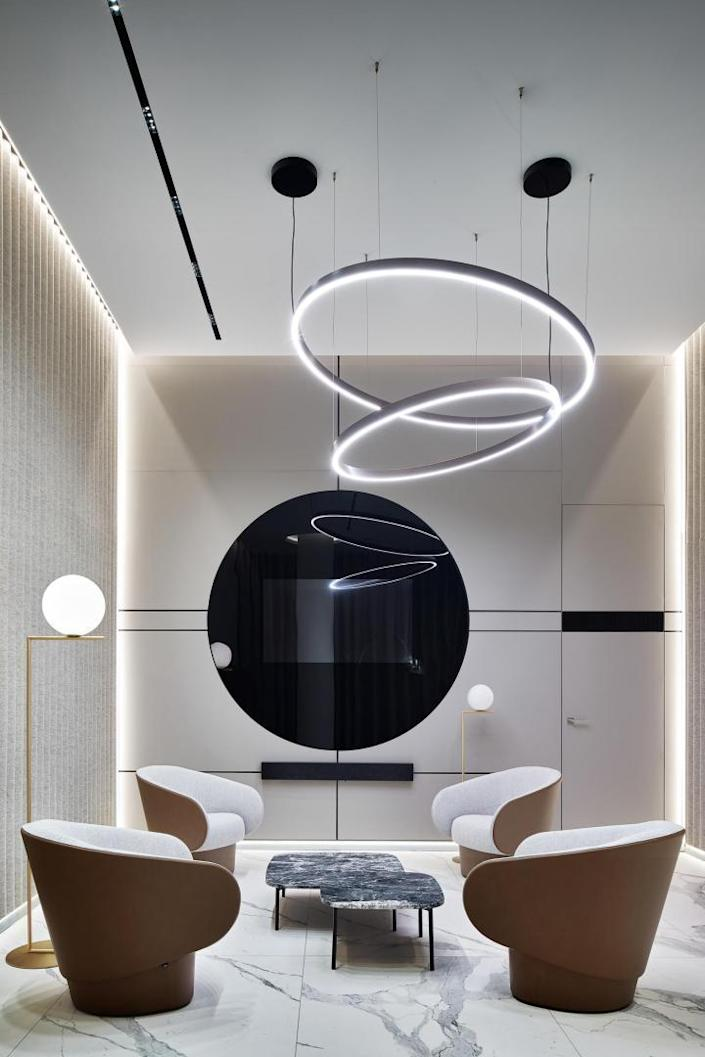 A more private meeting room inside the VIP lounge, complete with comfortable seating and lots of circular decor pieces.