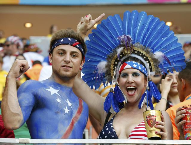 U.S. fans cheer during the 2014 World Cup G soccer match between Portugal and the U.S. at the Amazonia arena in Manaus June 22, 2014. REUTERS/Siphiwe Sibeko (BRAZIL - Tags: SOCCER SPORT WORLD CUP)