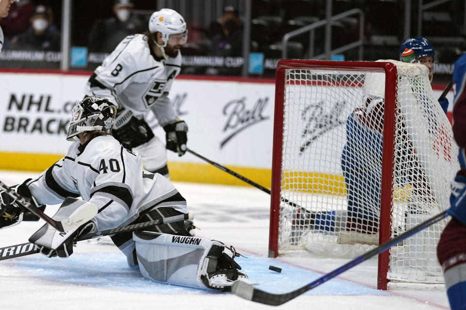 Los Angeles Kings goaltender Calvin Petersen (40) lets the puck slip past for a Colorado Avalanche left wing J.T. Compher (37) hat trick during the second period of an NHL hockey game Wednesday, May, 12, 2021, in Denver. (AP Photo/Jack Dempsey)