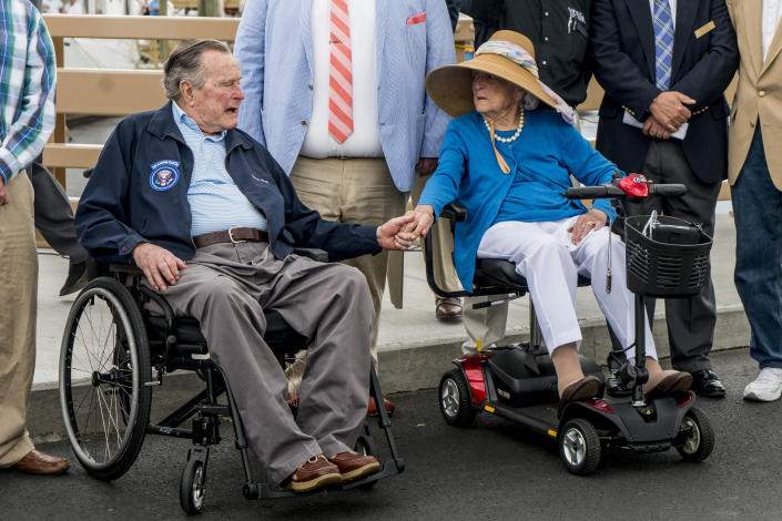 <p>Former President George H.W. Bush and first lady Barbara Bush hold hands and talk before the dedication of the Mathew J. Lanigan bridge that connects Kennebunk and Kennebunkport in Maine, May 19, 2017. (Photo: Gabe Souza/Portland Press Herald via Getty Images) </p>