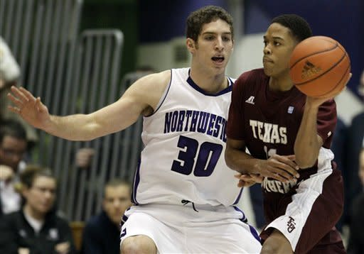 Texas Southern guard Lawrence Johnson-Danner, right, looks to a pass as Northwestern forward Davide Curletti guards during the first half of an NCAA college basketball game in Evanston, Ill., on Thursday, Dec. 15, 2011. (AP Photo/Nam Y. Huh)