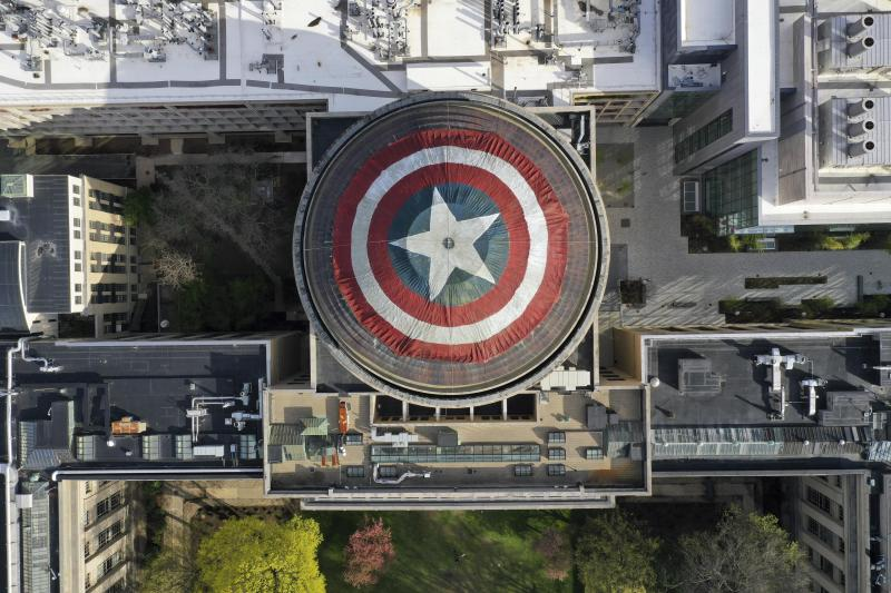 """This Sunday, April 28, 2019 photo provided by Raymond Huffman shows Massachusetts Institute of Technology's signature Great Dome draped with a giant cloth version of Captain America's red, white and blue shield, in Cambridge, Mass. MIT students for generations have centered similar pranks on the dome, this time drawing inspiration from America's hottest movie, """"Avengers: Endgame."""" The shield went up Saturday night and was taken down Monday morning. (Raymond Huffman via AP)"""