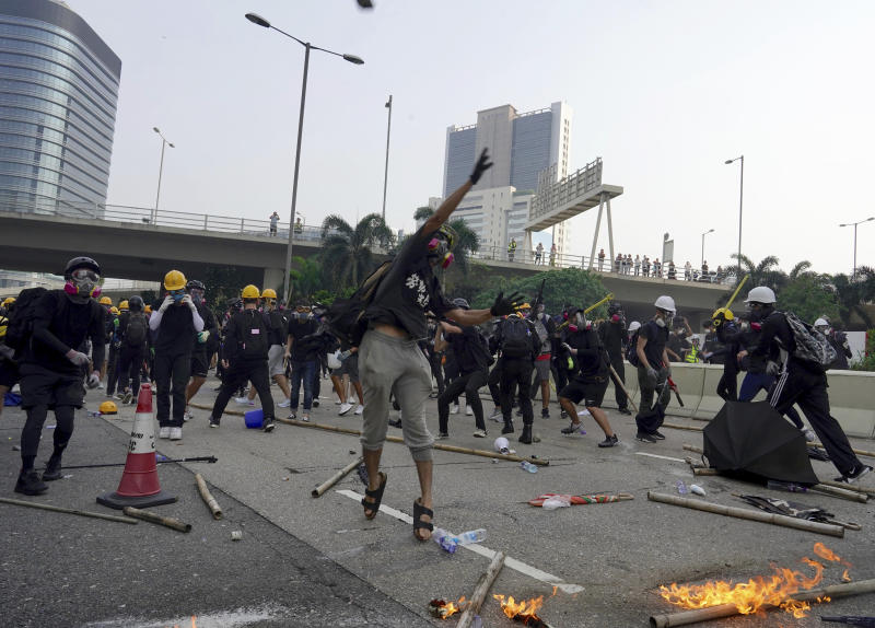 """Demonstrators clash with police during a protest in Hong Kong, Saturday, Aug. 24, 2019. Chinese police said Saturday they released an employee at the British Consulate in Hong Kong as the city's pro-democracy protesters took to the streets again, this time to call for the removal of """"smart lampposts"""" that raised fears of stepped-up surveillance. (AP Photo/Vincent Yu)"""