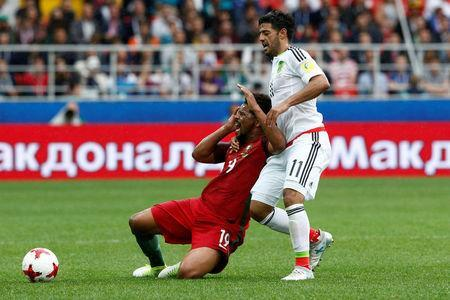 Soccer Football - Portugal v Mexico - FIFA Confederations Cup Russia 2017 - Third Placed Play Off - Spartak Stadium, Moscow, Russia - July 2, 2017 Portugal's Eliseu in action with Mexico's Carlos Vela REUTERS/Sergei Karpukhin