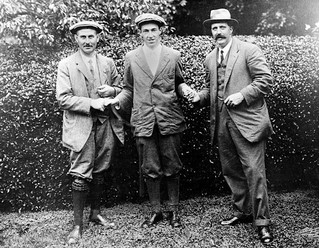 "<div class=""caption""> Ouimet, center, shakes hands with Vardon, left, and Ray, both of Britain, at the 1913 U.S. Open at The Country Club. </div> <cite class=""credit"">AP</cite>"