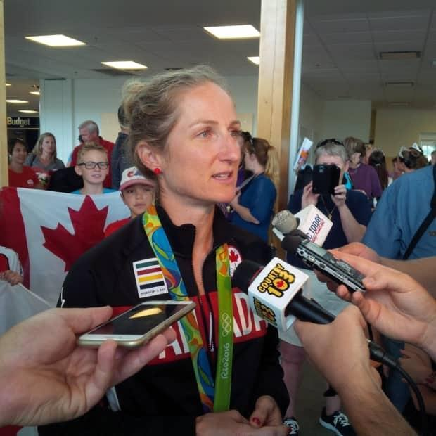 Set to compete in her fourth Olympics — her first as a mother — Catharine Pendrel, who resides in Kamloops, B.C., has closely watched Mandy Bujold and Kim Gaucher's battle with the IOC. (Tara Copeland/CBC - image credit)