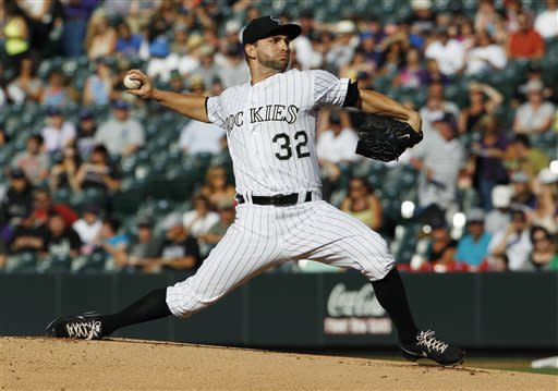 Colorado Rockies starting pitcher Tyler Chatwood works against the Los Angeles Dodgers in the first inning of a baseball game in Denver, Wednesday, July 3, 2013. (AP Photo/David Zalubowski)