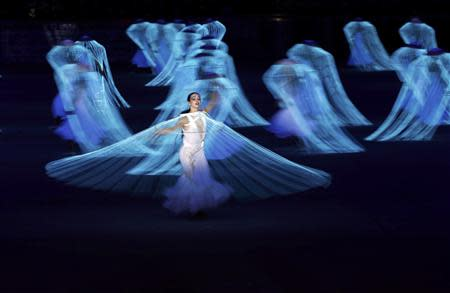 Performers participate in the opening ceremony of the 2014 Sochi Winter Olympics, February 7, 2014. REUTERS/Phil Noble