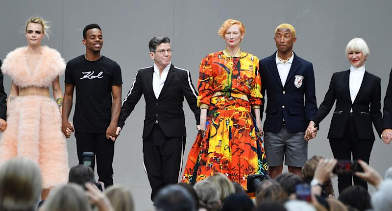 (From left) Cara Delevingne, Lil Buck, Robert Carsen, Tilda Swinton, Pharell Williams and Helen Mirren at the Karl Lagerfeld Homage at Grand Palais on June 20, 2019 in Paris, France. [Photo: Getty]