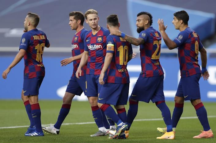 Players of Barcelona celebrate their sides first goal during the Champions League quarterfinal match between FC Barcelona and Bayern Munich at the Luz stadium in Lisbon, Portugal, Friday, Aug. 14, 2020. (AP Photo/Manu Fernandez/Pool)