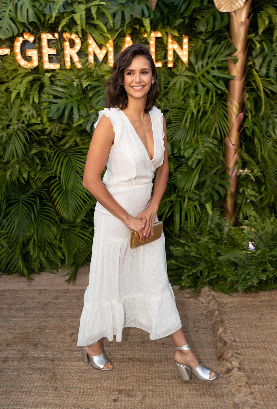 <p>Nina Dobrev wore a crisp summer dress for the St Germain party in Malibu on 10 July. Oh, and we need her shoes… <em>[Photo: Getty]</em> </p>