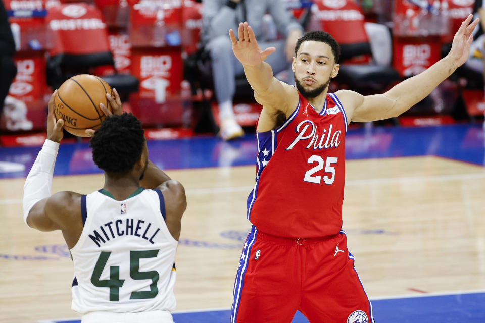 Ben Simmons #25 of the Philadelphia 76ers guards Donovan Mitchell #45 of the Utah Jazz during the fourth quarter at Wells Fargo Center on March 03, 2021 in Philadelphia, Pennsylvania. NOTE TO USER: User expressly acknowledges and agrees that, by downloading and or using this photograph, User is consenting to the terms and conditions of the Getty Images License Agreement. (Photo by Tim Nwachukwu/Getty Images)