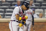 Atlanta Braves' Ronald Acuña Jr. reacts while crossing the plate after hitting a solo home run during the fifth inning of the second baseball game of a doubleheader against the New York Mets, Monday, June 21, 2021, in New York. (AP Photo/Kathy Willens)