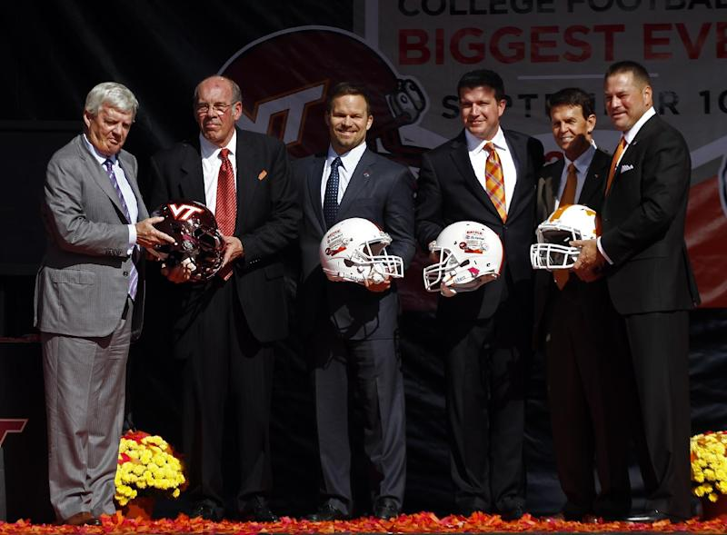 """From left, Virginia Tech head football coach Frank Beamer, Virginia Tech athletic director Jim Weaver, Marcus Smith, president of Speedway Motorsports, Jerry Caldwell, general manager of Bristol Motor Speedway, Tennessee athletic director, Dave Hart, and Tennessee head football coach Butch Jones pose after a press conference at Bristol Motor Speedway Monday, Oct. 14, 2013, in Bristol, Tenn. Tennessee and Virginia Tech will finally play a football game at Bristol Motor Speedway in what is being billed as the """"Battle of Bristol."""" (AP Photo/Wade Payne)"""