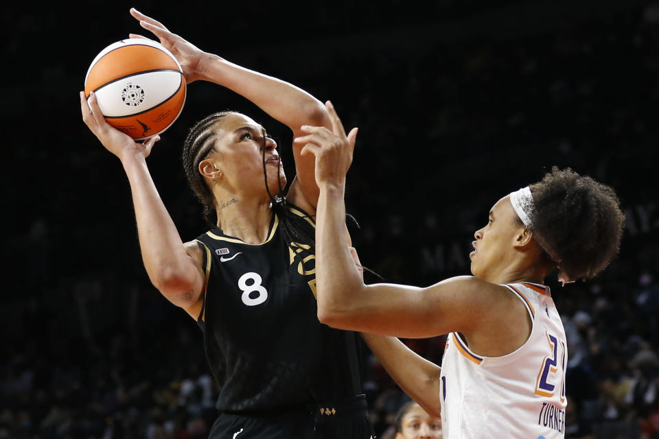 Las Vegas Aces center Liz Cambage (8) shoots against Phoenix Mercury forward Brianna Turner (21) during the second half of Game 5 of a WNBA basketball playoff series, Friday, Oct. 8, 2021, in Las Vegas. (AP Photo/Chase Stevens)