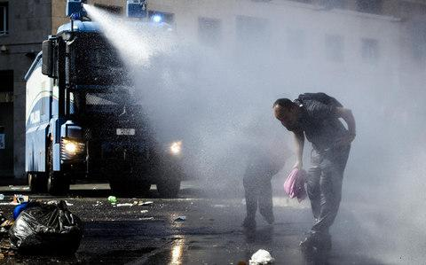 Police used water cannons during the protest - Credit: Ansa