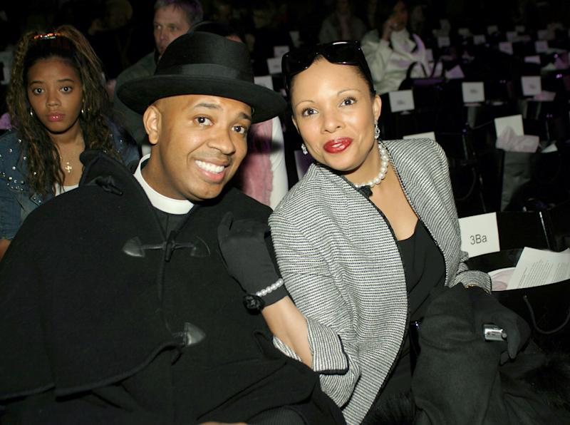 Reverend Run and Justine Simmons during Olympus Fashion Week Fall 2004 - Baby Phat - Front Row and Backstage at Gotham Hall in New York City, New York, United States. (Photo by Johnny Nunez/WireImage)