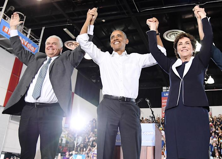 From left, Clark County Commission Chairman and Democratic gubernatorial candidate Steve Sisolak, former President Barack Obama, and U.S. Senate candidate Rep. Jacky Rosen at a get-out-the-vote rally at the Cox Pavilion as Obama campaigns for Nevada Democratic candidates on Oct. 22, 2018, in Las Vegas. (Photo: Ethan Miller/Getty Images)