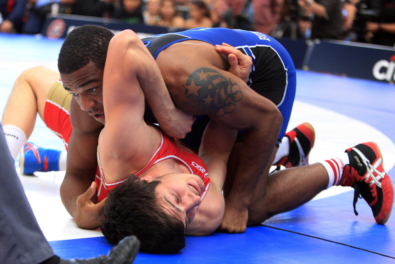 Jordan Burroughs, above, competes with Kamel Malikov, of Russia, in a 163-pound bout during a freestyle wrestling event in New York's Times Square on Thursday, June 7, 2012. Burroughs won the match. (AP Photo/Frank Franklin II)