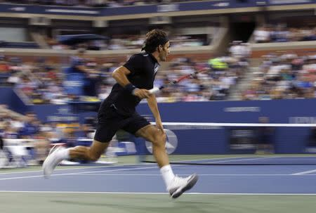 Roger Federer of Switzerland chases down a ball as he plays against Marinko Matosevic of Australia during their first round men's single match at the U.S. Open tennis tournament in New York, August 26, 2014. REUTERS/Shannon Stapleton
