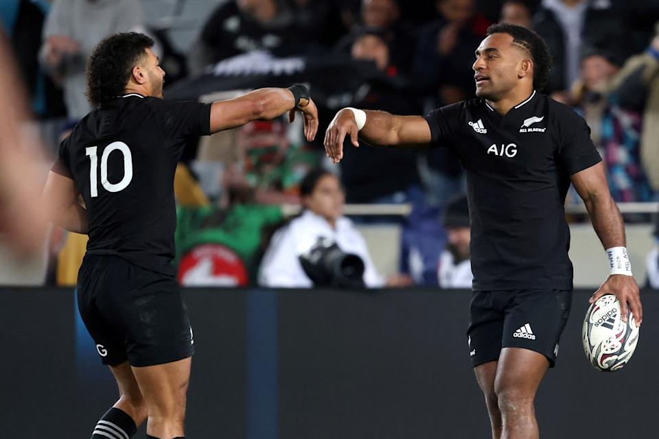 New Zealand's Sevu Reece (pictured right) celebrates a try with a teammate Richie Mounga (pictured left) during the second match of Bledisloe Cup.