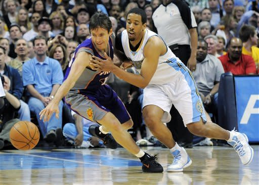 Phoenix Suns guard Steve Nash (13) and Denver Nuggets guard Andre Miller (24) go after a loose ball during the fourth quarter of an NBA basketball game on Friday, April 6, 2012, in Denver. Denver won 105-99. (AP Photo/Jack Dempsey)