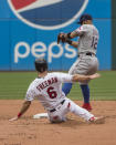 Texas Rangers' Rougned Odor forces Cleveland Indians' Mike Freeman out at second base during the fifth inning of the first game of a baseball doubleheader in Cleveland, Wednesday, Aug. 7, 2019. (AP Photo/Phil Long)
